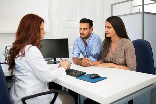Couple consulting with Physician