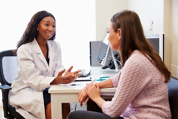 Woman Consulting with Physician